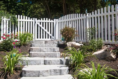 Stone Steps Leading Up To White Picket Fence