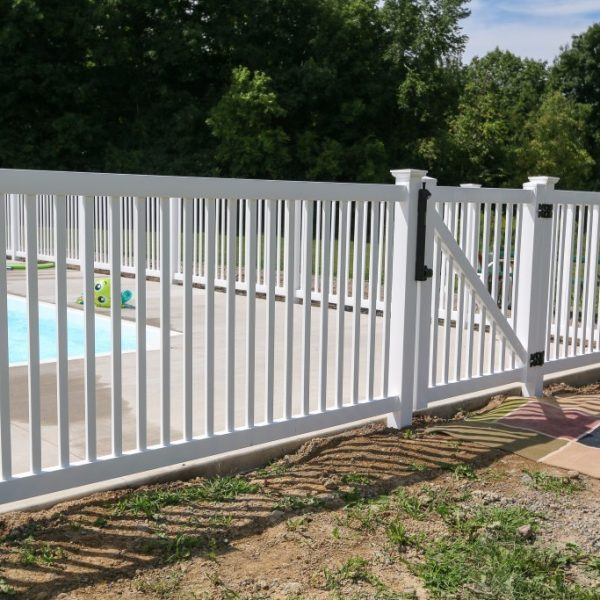 Pool with white vinyl fence and gate