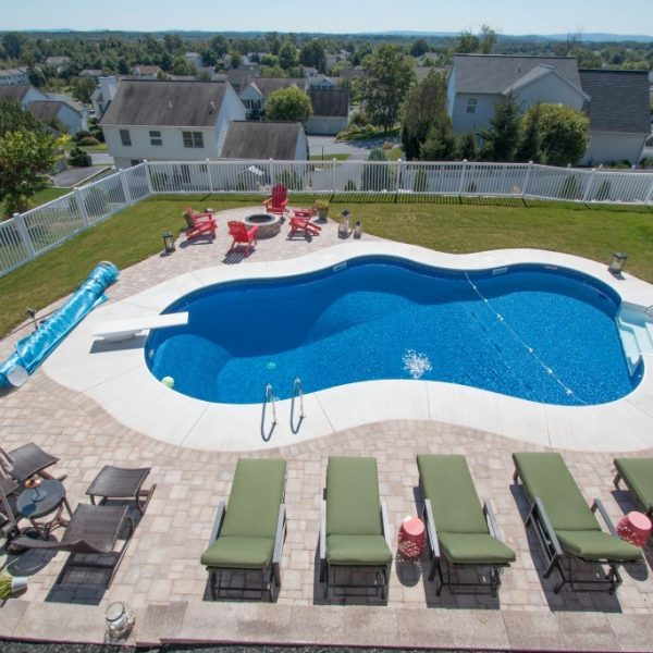 Large pool surrounded by white vinyl fencing