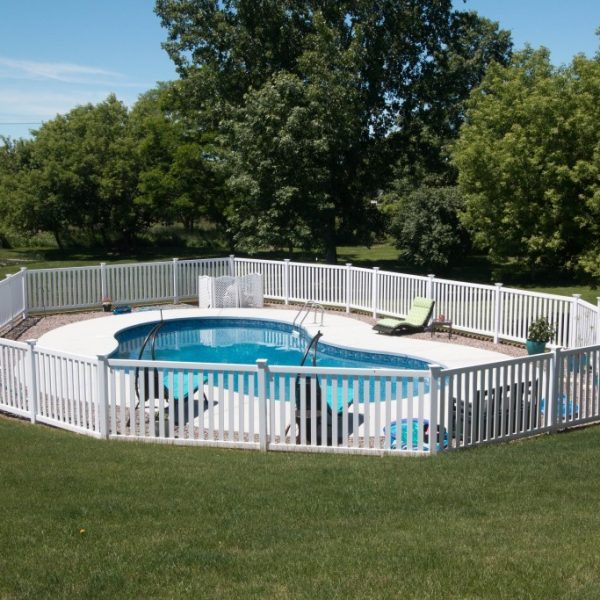 White vinyl fence around pool
