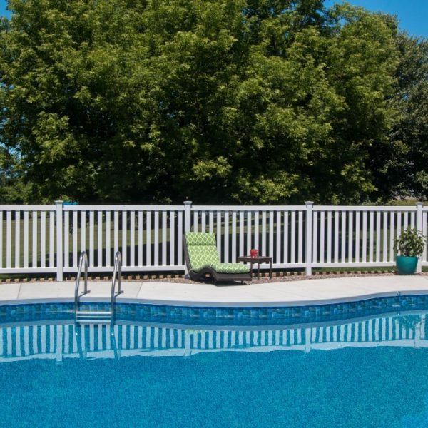 White vinyl fence surrounding pool