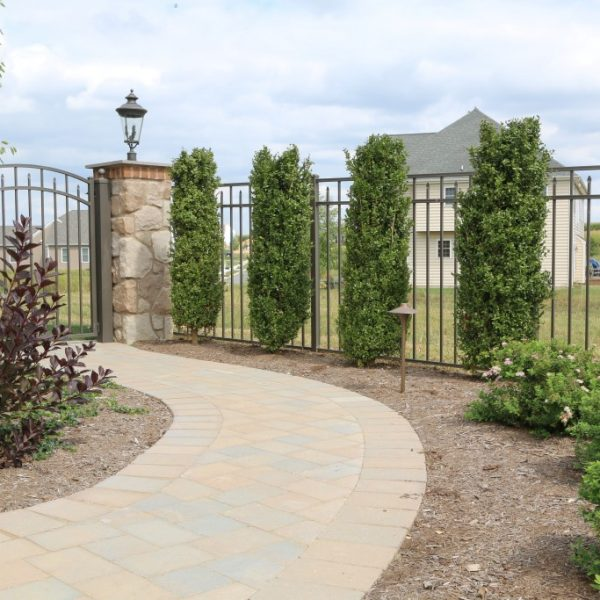 Brown Aluminum Regis Yard Fencing with Stone Pillars