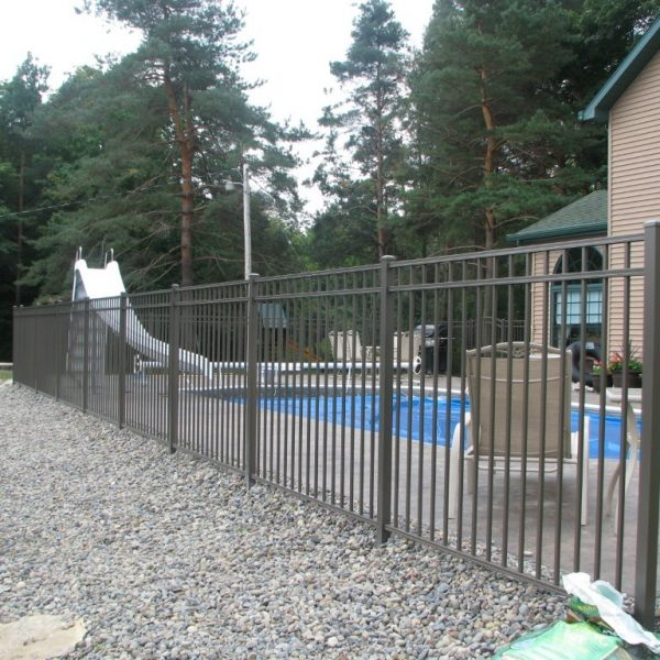 Yard with Brown Aluminum Regis Fence