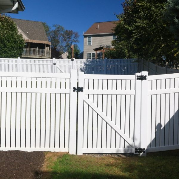 White vinyl fencing with a gate