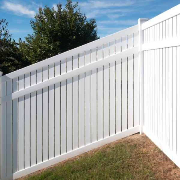 Sloped white vinyl fence