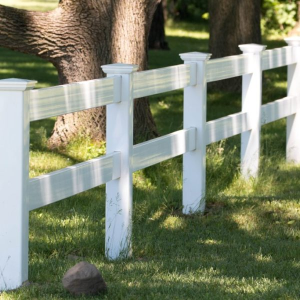 White vinyl two-rail fencing