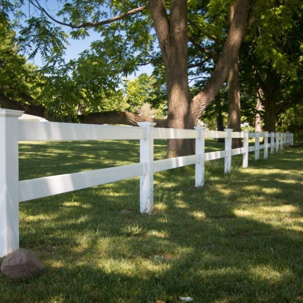 White vinyl two-rail fence