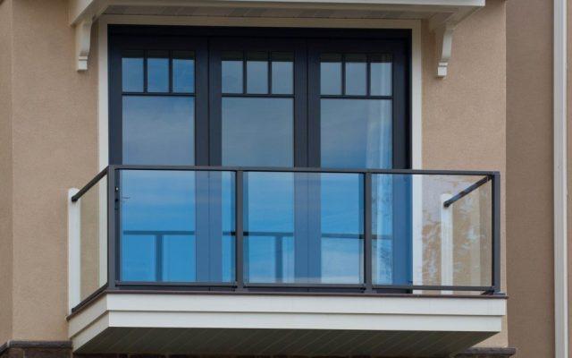 An aluminum and glass railing on a veranda
