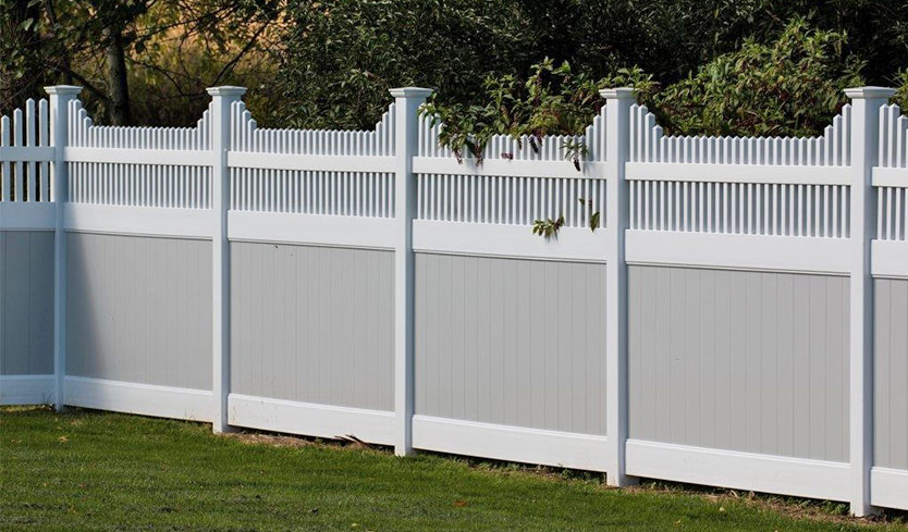 gray and white vinyl fences